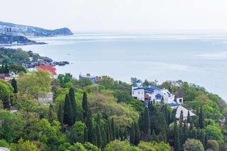rocky mountain juniper: green park with beautiful villas on the Black Sea Stock Photo
