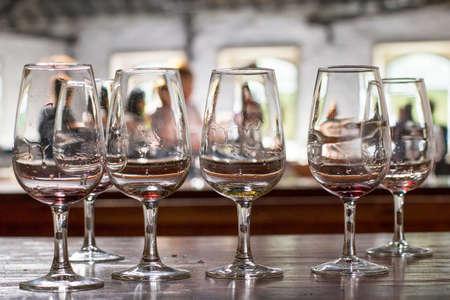 portugal agriculture: background empty wine glasses in the room for tasting Port wine in Villa Nova de Gaia, Porto, Portugal Stock Photo