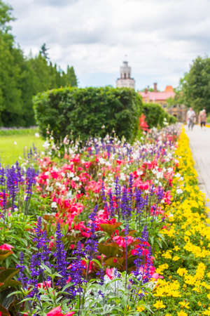 background landscape view of the bright colorful garden and a new castle in Sigulda, near Riga, Latvia
