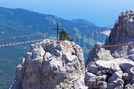 background landscape rope bridges between the peaks of Mount Ai-Petri at high altitude, Yalta, Crimea Stock Photo