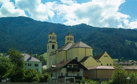 Background view of a small church in an alpine village in Tyrol