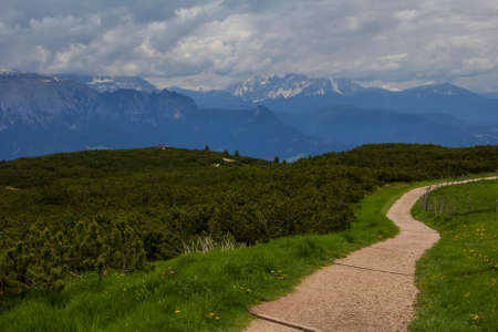 Landscape view of the walking trail near the observation deck on the top of the mountain, in the vicinity of Bolzano, Italy