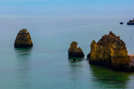 background landscape: Atlantic ocean and the beach with caves and islands in Lagos, Portugal