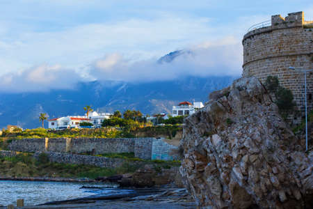 background landscape view of the quay of Kyrenia and the tower of the Kirinis fortress on the northern coast of the island of Cyprus
