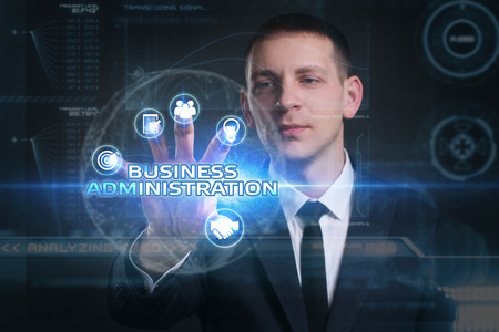 administracion de empresas: Business, Technology, Internet and network concept. Young businessman working on a virtual screen of the future and sees the inscription: business administration Foto de archivo
