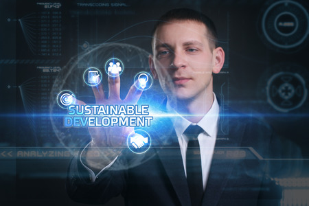 desarrollo sostenible: Business, Technology, Internet and network concept. Young businessman working on a virtual screen of the future and sees the inscription: sustainable development Foto de archivo