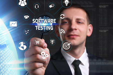 Business, Technology, Internet and network concept. Young businessman working on a virtual screen of the future and sees the inscription: software testing
