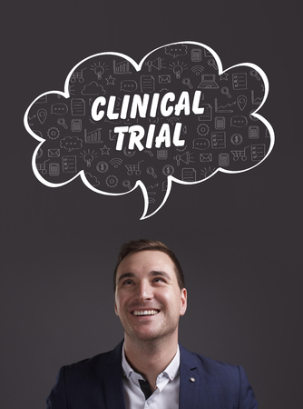 clinical trial: Business, Technology, Internet and marketing. Young businessman thinking about: clinical trial