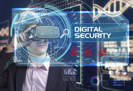 Business, Technology, Internet and network concept. Young businessman working in virtual reality glasses sees the inscription: Digital security Stock Photo