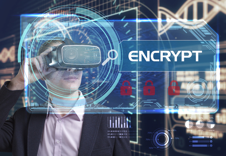 encrypt: Business, Technology, Internet and network concept. Young businessman working in virtual reality glasses sees the inscription: encrypt Stock Photo