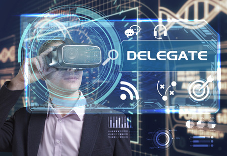 delegar: Business, Technology, Internet and network concept. Young businessman working in virtual reality glasses sees the inscription: delegate