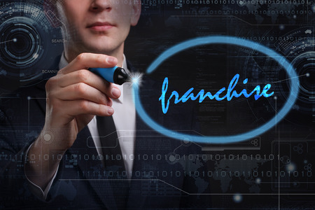 Business, Technology, Internet and network concept. Young business man writing word: franchise