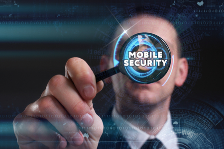 control fraud: Business, Technology, Internet and network concept. Young businessman working on a virtual screen of the future and sees the inscription: mobile security