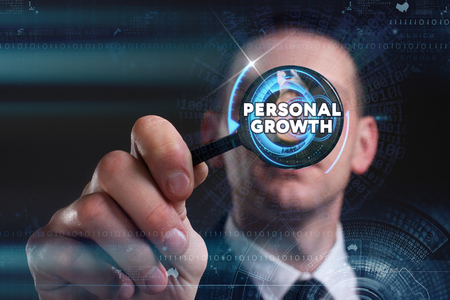 superacion personal: Business, Technology, Internet and network concept. Young businessman working on a virtual screen of the future and sees the inscription: personal growth
