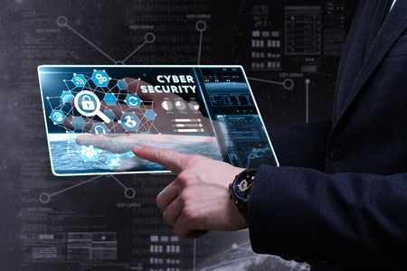 security technology: Business, Technology, Internet and network concept. Young businessman working on a virtual screen of the future and sees the inscription: cyber security Stock Photo