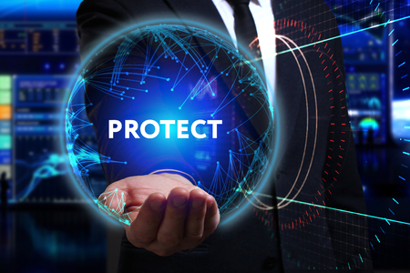 protect: Business, Technology, Internet and network concept. Young businessman working in the field of the future, he sees the inscription: protect