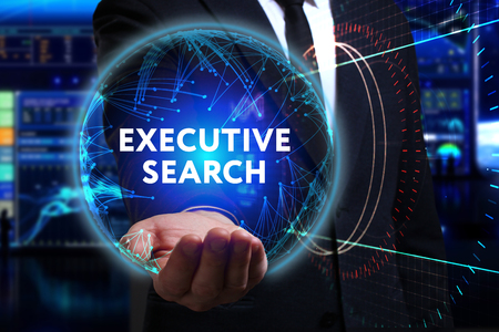 executive search: Business, Technology, Internet and network concept. Young businessman working in the field of the future, he sees the inscription: executive search