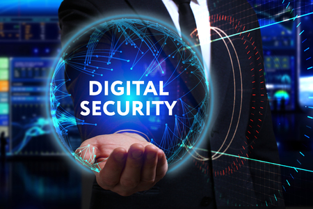 control fraud: Business, Technology, Internet and network concept. Young businessman working in the field of the future, he sees the inscription: digital security Stock Photo