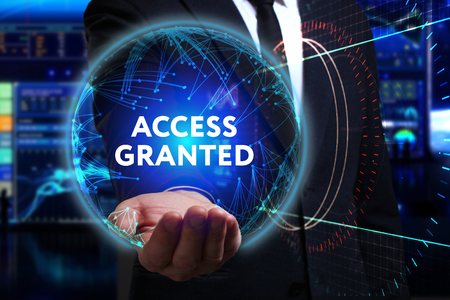 access granted: Business, Technology, Internet and network concept. Young businessman working in the field of the future, he sees the inscription: access granted