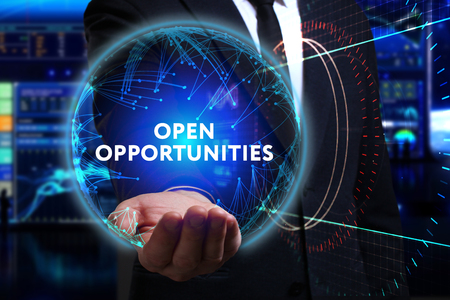 control fraud: Business, Technology, Internet and network concept. Young businessman working in the field of the future, he sees the inscription: open opportunities Stock Photo