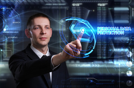 control fraud: Business, Technology, Internet and network concept. Young businessman working on a virtual blackboard of the future, he sees the inscription: personal data protection