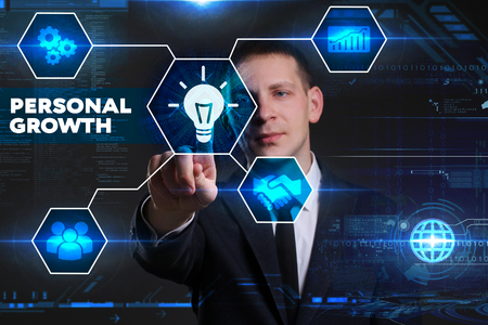 superacion personal: Business, Technology, Internet and network concept. Young businessman working on a virtual blackboard of the future, he sees the inscription: personal growth Foto de archivo