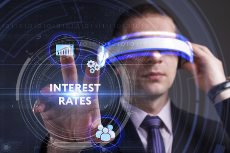 interest rates: Business, Technology, Internet and network concept. Young businessman working in virtual reality glasses sees the inscription: Interest rates