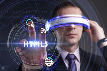 Business, Technology, Internet and network concept. Young businessman working in virtual reality glasses sees the inscription: HTML5