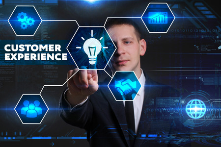 Business, Technology, Internet and network concept. Young businessman working on a virtual blackboard of the future, he sees the inscription: customer experience