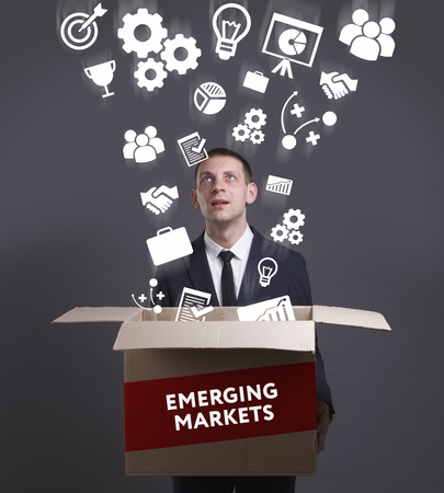 emerging economy: Business, Technology, Internet and network concept. Young businessman shows the word: Emerging markets