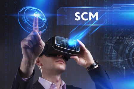 scm: Business, Technology, Internet and network concept. Young businessman working in virtual reality glasses sees the inscription: SCM