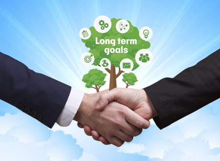 Technology, the Internet, business and network concept. Businessmen shake hands: Long term goals