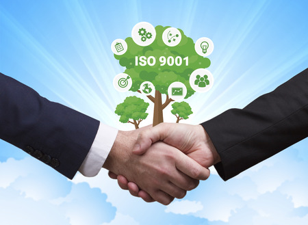 Technology, the Internet, business and network concept. Businessmen shake hands: ISO 9001 Stock Photo
