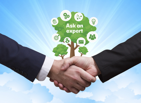 Technology, the Internet, business and network concept. Businessmen shake hands: Ask an expert Stock Photo