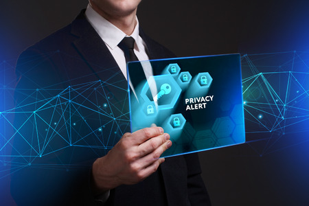 control fraud: Business, Technology, Internet and network concept. Young businessman working on a virtual screen of the future and sees the inscription: Privacy alert Stock Photo