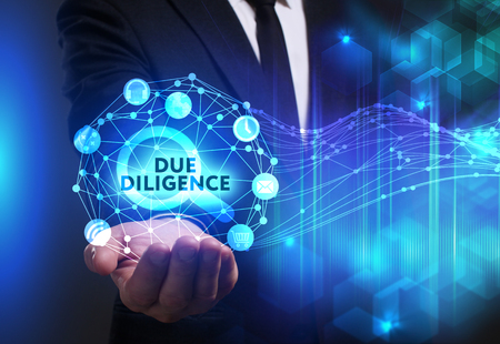 Business, Technology, Internet and network concept. Young businessman working on a virtual screen of the future and sees the inscription: Due diligence Stock Photo