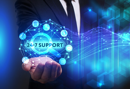 Business, Technology, Internet and network concept. Young businessman working on a virtual screen of the future and sees the inscription: 24-7 Support