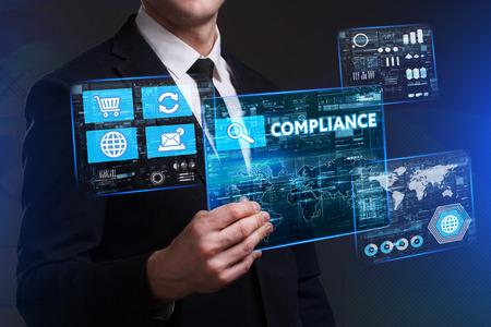keywords link: Business, Technology, Internet and network concept. Young businessman working on a virtual screen of the future and sees the inscription: Compliance