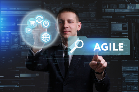 keywords link: Business, Technology, Internet and network concept. Young businessman working on a virtual screen of the future and sees the inscription: Agile