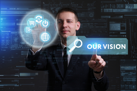 keywords link: Business, Technology, Internet and network concept. Young businessman working on a virtual screen of the future and sees the inscription: Our vision