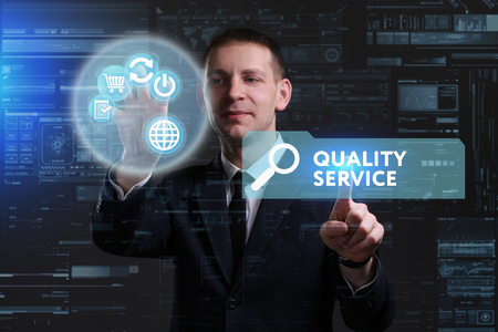 keywords link: Business, Technology, Internet and network concept. Young businessman working on a virtual screen of the future and sees the inscription: Quality service Stock Photo