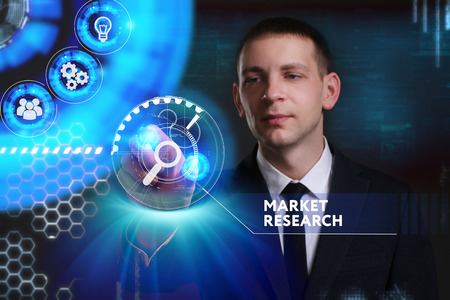 Business, Technology, Internet and network concept. Young businessman working on a virtual screen of the future and sees the inscription: Market research Stock Photo