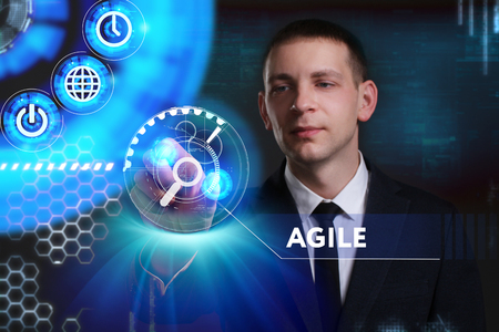 keyword: Business, Technology, Internet and network concept. Young businessman working on a virtual screen of the future and sees the inscription: Agile