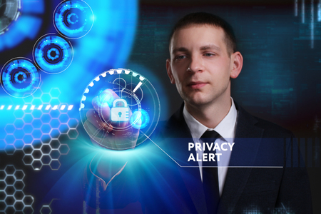 Business, Technology, Internet and network concept. Young businessman working on a virtual screen of the future and sees the inscription: Privacy alert Stock Photo