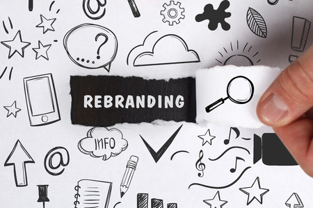 keyword: Business, Technology, Internet and network concept. Young businessman shows the word: Rebranding