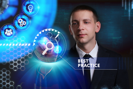 Business, Technology, Internet and network concept. Young businessman working on a virtual screen of the future and sees the inscription: Best practice