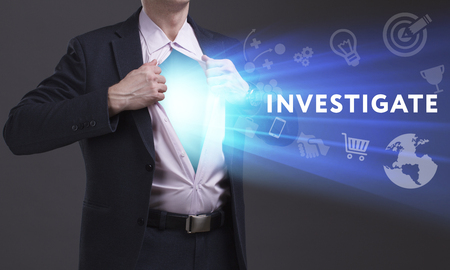 keywords link: Business, Technology, Internet and network concept. Young businessman shows the word: Investigate Stock Photo