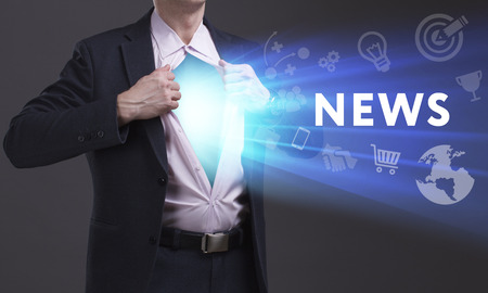 keywords link: Business, Technology, Internet and network concept. Young businessman shows the word: News Stock Photo