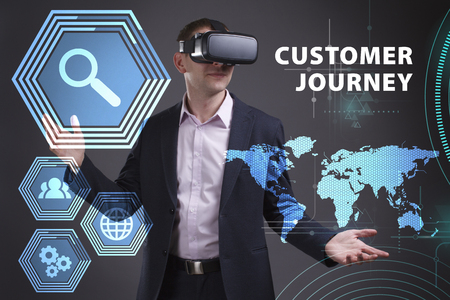 keywords link: Business, Technology, Internet and network concept. Young businessman working on a virtual screen of the future and sees the inscription: Customer journey Stock Photo