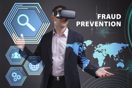 keywords link: Business, Technology, Internet and network concept. Young businessman working on a virtual screen of the future and sees the inscription: Fraud prevention